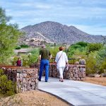 Visitors walk through Desert Arroyo Park