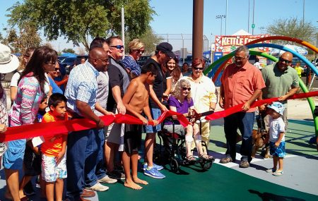 Crowd watchesAvondale City Councilwoman Sandi Nielson, who is confined to a wheelchair, cut ribbon on Friendship Park's opening day