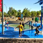 Kids play at the Surprise Farms Park splash pad