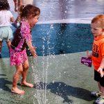 Children enjoy water jets at Friendship Park splash pad