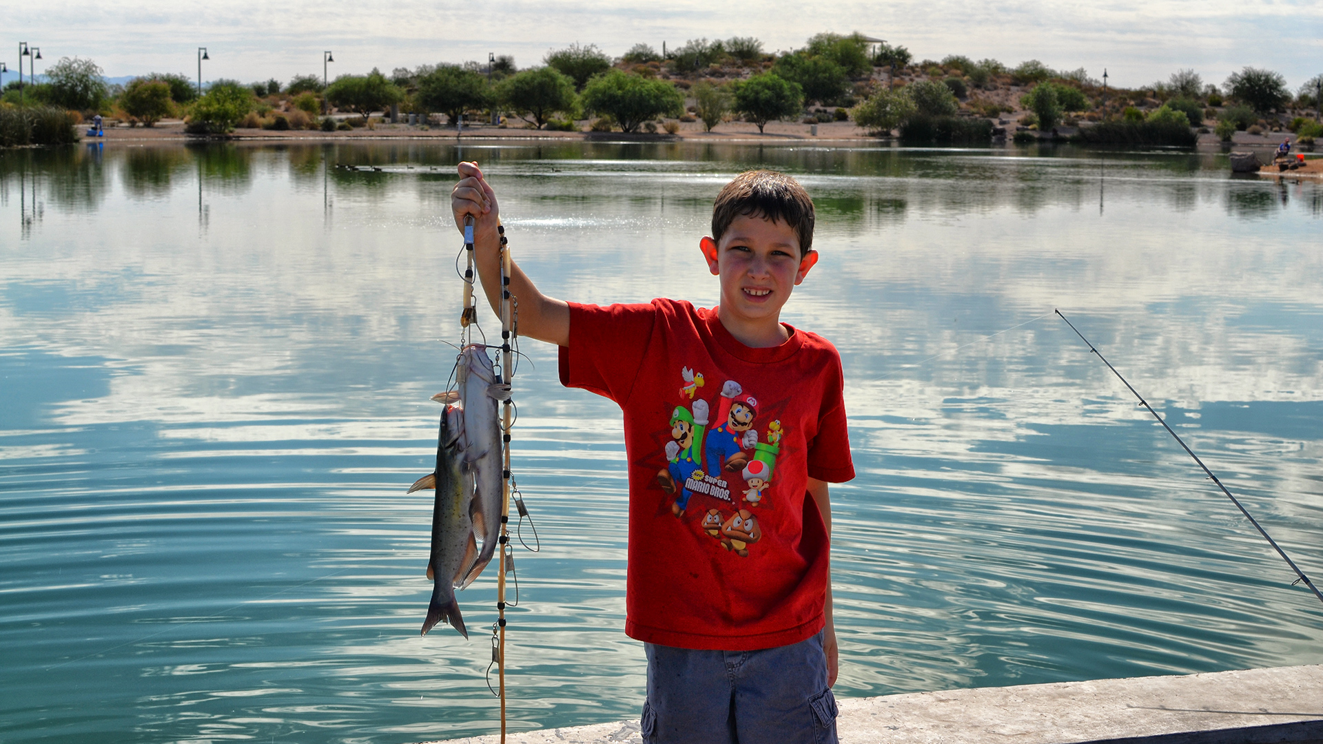 Boy with freshly caught fish