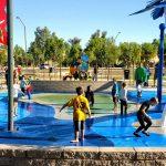 Kids play at the Surprise Farms Park splash pad